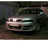 Бампер передний Mitsubishi-Carisma var 2